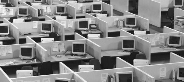 Picture of open office with old computers and desks